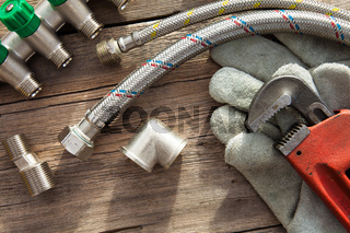 Set of plumbing and tools on the wooden table