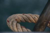 Detail Closeup Of A Bent Rigid Ship Rope