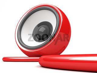red speaker with cable over white