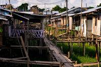 Boardwalk in street of village on stilts in the Amazon of Peru