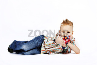 school boy with his colorful toy gun