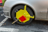 Karlovy Vary, Czech Republic - October 30, 2017: Car was locked with clamped vehicle wheel lock