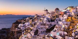 Oia village at sunset, Santorini island, Greece.