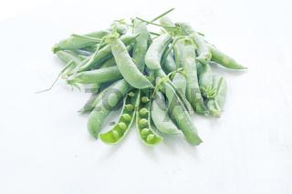 Fresh green peas in their pods