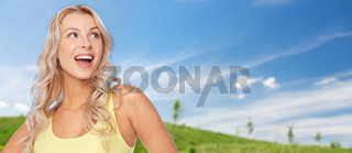 smiling young woman with blonde hair in summer