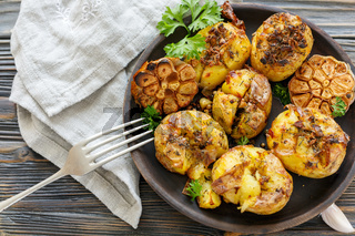 Baked potatoes with spices, olive oil and garlic.