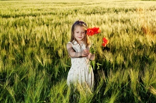 An image of a little girl in the field