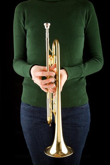 beautiful girl holds a golden trumpet