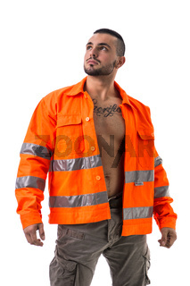 Handsome young construction worker with orange suit