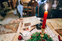 Candlesticks with red candle on the table