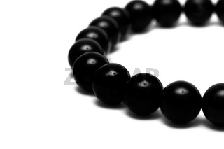 Black beads isolated on white background