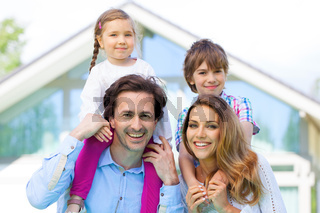Happy family and their house