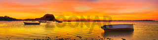 Fishing boat at sunset time. Le Morn Brabant on background. Panorama
