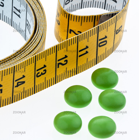 Measuring tape and tablets, as a symbol for diet pills