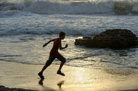 Boy runs along the seashore