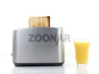Plain white toast in a toaster isolated against a white background