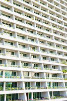 Modern city building exterior with many rooms with balconies