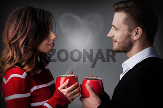 Couple with coffee and heart shaped steam