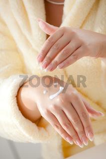 Femal hands applying cream
