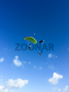 Three skydivers in the sky, Cuba, Varadero