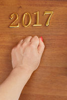 Hand and numbers 2017 on door - new year background
