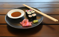 Closeup Of Tasty Japanese Sea Food On A Plate With Fish And Chopsticks
