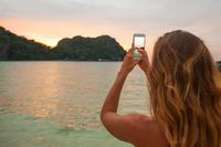Woman taking photos in Thailand
