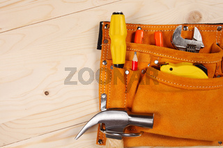 Set of working tools on wooden background