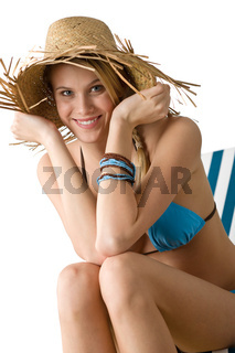 Beach - Happy woman in bikini with straw hat