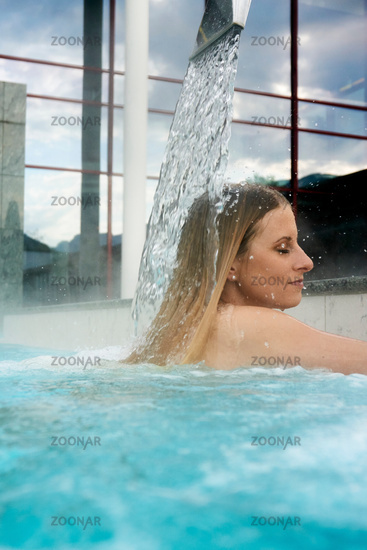Young woman in an outdoor pool of a spa
