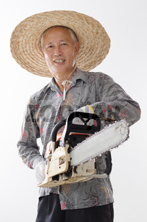 Asian old man holding chainsaw