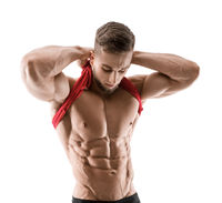 Cute young sports man shows relief abdominal muscles isolated on white