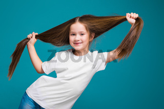 Cute girl in tee shirt with long hair