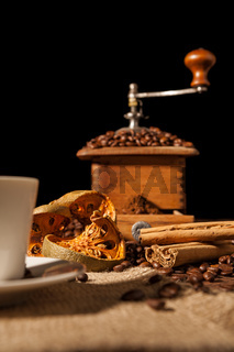 Close-up on dried orange fruit and cinnamon and coffee-beans