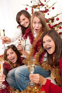 Four young woman having fun on Christmas