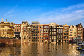 Amsterdam city skyline at Damrak canal waterfront, Amsterdam, Netherlands
