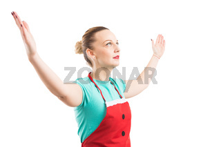 Woman wearing red apron rising lifting both hands
