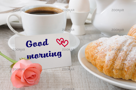 Breakfast of croissants   chocolate filling cup of fresh morning coffee and a card with a wish Good