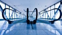 Escatator in blue hall