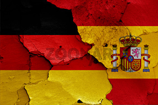 flags of Germany and Spain painted on cracked wall