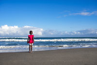 Little Girl in Pink on Beach