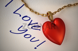 Red shiny heart pendant, with gold chain, on a white paper and the type I love you, hand written.