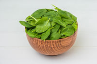 Spring spinach leaves in the bowl.