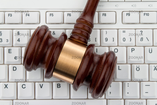 Judge's hammer and keyboard. Legal security on the Internet