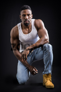 Male black bodybuilder wearing white tanktop