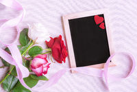 Roses and chalkboard with red hearts