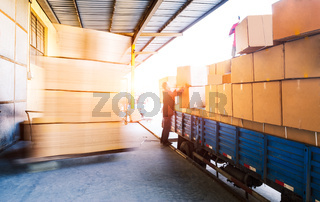 truck with goods before warehouse