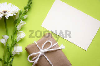 Flowers with message card and gift