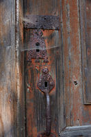 Padlock with cobwebs on church door