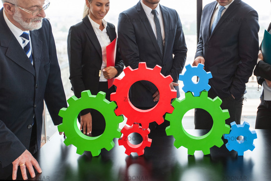 Business people and cogwheels